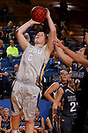 BROOKINGS, SD - OCTOBER 30:  Chynna Stevens #0 from South Dakota State University lays the ball up for two points past Stacie Hull #42 from South Dakota School of Mines in the first half of their exhibition game Thursday night at Frost Arena in Brookings. (Photo by Dave Eggen/Inertia)