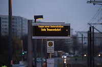 """Mehr als 3.500 Menschen protestierten am Samstag den 22. November 2014 in Berlin Marzahn-Hellersdorf gegen einen Aufmarsch von ca. 550 Neonazis, Hooligans, NPD-Mitgliedern, Mitgliedern der Neonazipartei """"Die Rechte"""", sowie einer sog. Buergerinitiative """"Gegen Asylmissbrauch den Mund aufmachen"""".<br /> Die Rechtsradikalen wollten gegen eine geplante Fluechtlingsunterkunft protestieren und durch den Stadtteil marschieren.<br /> Dagegen versammelten sich bereits Stunden vor dem Neonazi-Aufmarsch ueber 1.500 Menschen an mehreren Punkten der Marschroute an den Polizeiabsperrungen.<br /> Bis zum Einbruch der Dunkelheit konnte der rechtsradikale Aufmarsch nur ca. 70 Meter Wegstrecke zurueck legen und wurde dann von der Polizei in einer chaotischen Aktion zum S-Bahnhof gebracht. Gegendemonstranten gelang es nach unverstaendlichen Polizeimanoevern bis auf wenige Meter an die Rechtsradikalen zu gelangen und es kam zu Auseinandersetzungen bei denen beide Seiten sich mit Flaschen, Steinen und Feuerwerkskoerpern bewarfen.<br /> Im Bild: Der Tram-Verkehr war stundenlag eingestellt.<br /> 22.11.2014, Berlin<br /> Copyright: Christian-Ditsch.de<br /> [Inhaltsveraendernde Manipulation des Fotos nur nach ausdruecklicher Genehmigung des Fotografen. Vereinbarungen ueber Abtretung von Persoenlichkeitsrechten/Model Release der abgebildeten Person/Personen liegen nicht vor. NO MODEL RELEASE! Nur fuer Redaktionelle Zwecke. Don't publish without copyright Christian-Ditsch.de, Veroeffentlichung nur mit Fotografennennung, sowie gegen Honorar, MwSt. und Beleg. Konto: I N G - D i B a, IBAN DE58500105175400192269, BIC INGDDEFFXXX, Kontakt: post@christian-ditsch.de<br /> Bei der Bearbeitung der Dateiinformationen darf die Urheberkennzeichnung in den EXIF- und  IPTC-Daten nicht entfernt werden, diese sind in digitalen Medien nach §95c UrhG rechtlich geschuetzt. Der Urhebervermerk wird gemaess §13 UrhG verlangt.]"""