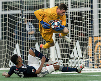 FOXBOROUGH, MA - JUNE 26: Matt Freese #1 completes a save as Juan Agudelo #17 closes during a game between Philadelphia Union and New England Revolution at Gillette Stadium on June 26, 2019 in Foxborough, Massachusetts.