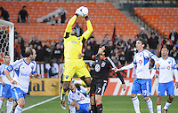 Montreal Impact goalkeeper Donovan Ricketts (1) goes up to make a save against D.C. United forward Dwayne De Rosario (7)  D.C. United tied The Montreal Impact 1-1, at RFK Stadium, Wednesday April 18 , 2012.