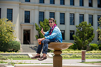 Graduate Will Nahmens celebrates and cools off in the JSC fountain. Occidental College commencement for the class of 2017, May 21, 2017.<br /> (Photo by Marc Campos, Occidental College Photographer)