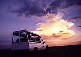 BOTSWANA, Africa, safari truck in Chobe National Park and Game Reserve at dusk