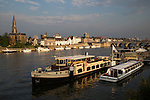 Evening light boats buildings, River Maas or Meuse, Maastricht, Limburg province, Netherlands,