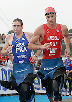 15 JUL 2007 - LORIENT, FRA - Charley Loisel (FRA) and Olivier Marceau (SUI) - World Elite Mens Long Distance Triathlon Championships. (PHOTO (C) NIGEL FARROW)