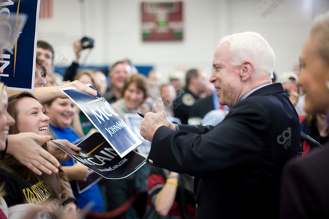"""Senator John McCain, Republican presidential candidate, and his wife, Cindy (right), campaign rally push for """"Super Tuesday"""" votes. Nashville, Tennessee, February 2, 2008."""