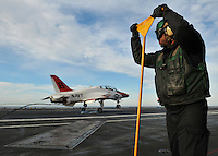 081211-N-7981E-108 PACIFIC OCEAN (December 11, 2008)- Aviation Boatswain's Mate (Equipment) Airman Derrick Provo stands by to guide arresting cables back into place as a T-45 Goshawk assigned to Carrier Training Wing (CTW) 2 makes an arrested landing on the flight deck of USS Abraham Lincoln (CVN 72).  Lincoln is underway on a scheduled work-up, conducting training and carrier qualifications.  (U.S. Navy photo by Mass Communication Specialist 2nd Class James R. Evans/Released)