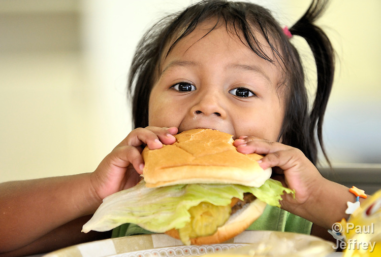 A girl enjoys her meal at the Good Neighbor Settlement House in Brownsville, Texas. The Settlement House, a project of United Methodist Women, provides a variety of services in the U.S.-Mexico border region, including free meals for hungry and homeless families.