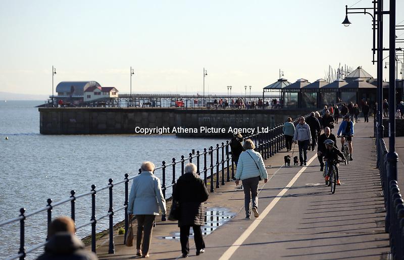 People enjoy a walk in Mumbles near Swansea, Wales, UK. Friday 27 October 2017