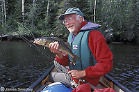 Man holding summer walleye fish