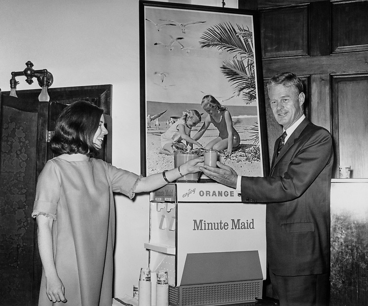 Rep. Edward Gurney, R-Fla., holding a glass of Orange Minute Maid juice, fresh from Florida, in 1966. (Photo by CQ Roll Call)