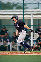 GCL Yankees East center fielder Ryder Green (28) follows through on a swing during the first game of a doubleheader against the GCL Pirates on July 31, 2018 at Pirate City Complex in Bradenton, Florida.  GCL Yankees East defeated GCL Pirates 2-0.  (Mike Janes/Four Seam Images)