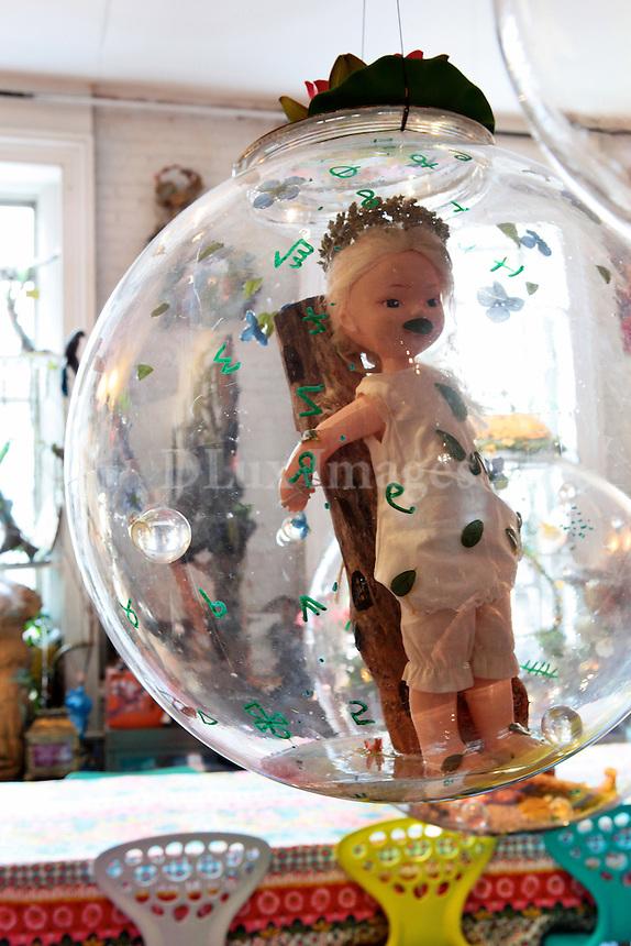 doll inside a glass ball