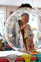 doll inside a glass ball