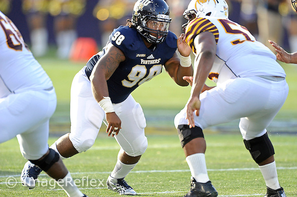 14 September 2013:  FIU defensive tackle Leonard Washington (98) rushes the quarterback in the first quarter as the Bethune-Cookman Wildcats defeated the FIU Golden Panthers, 34-13, at FIU Stadium in Miami, Florida.