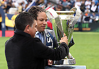 CARSON, CA - DECEMBER 01, 2012:  Cobi Jones and Mauricio Cienfuegos ex players of the Los Angeles Galaxy place the trophy on its stand before the 2012 MLS Cup at the Home Depot Center, in Carson, California on December 01, 2012. The Galaxy won 3-1.