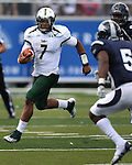 South Florida quarterback B.J. Daniels runs against Nevada during the second half of an NCAA college football game Saturday, Sept. 8, 2012, in Reno, Nev. South Florida won 32-31. (AP Photo/Cathleen Allison)