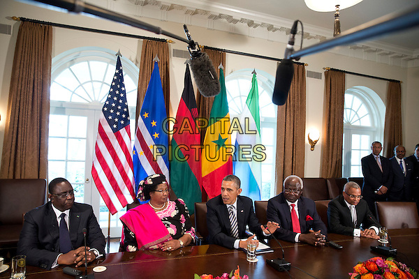 United States President Barack Obama speaks after meeting with President Macky Sall, left, of Senegal, President Joyce Banda ,second left, of Malawi, President Ernest Bai Koroma, second right, of Sierra Leone, and Prime Minister Jos» Maria Pereira Neves, right, of Cape Verde in the Cabinet Room of the White House in Washington, D.C., U.S., on Thursday, March 28, 2013. .half length black suit table sitting pink.CAP/ADM/CNP/JR.©Joshua Roberts/CNP/AdMedia/Capital Pictures.