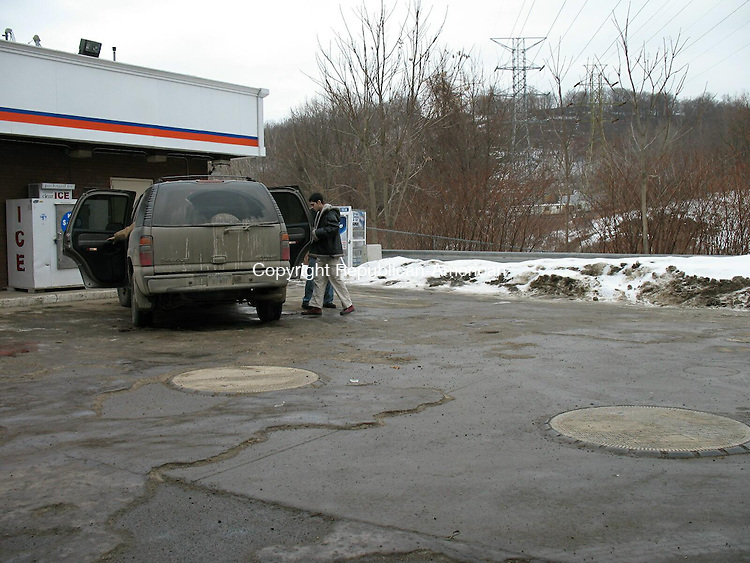 WATERBURY, CT - 08 February 2009 - 020709RA04 - This unidentified man gets in an unmarked Waterbury police sport utility vehicle on Saturday following a reported robbery at the Cumberland Farms, 1588 Watertown Ave.