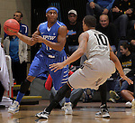 SIOUX FALLS, SD - MARCH 10:  Isaiah McCray #11 of IPFW looks past Duke Mondy #10 of Oakland University during their quarterfinal game at the 2013 Summit League Basketball Championships at the Sioux Falls Arena Sunday. (Photo by Dick Carlson/Inertia)