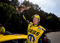 May 19, 2014; Commerce, GA, USA; NHRA pro stock driver Jeg Coughlin Jr celebrates after winning the Southern Nationals at Atlanta Dragway. Mandatory Credit: Mark J. Rebilas-USA TODAY Sports
