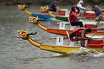 Vancouver, Canada, Aug 8th 2009. World Police and Fire Games, Dragon Boat Competition.  The Men's Open 10 Grand Championship race.  Boats approaching the finish line in a close race.  Only 43 hundredths of a second separated the first and fourth place teams in this race.  In the yellow boat is PNP Patriots (third place), in the orange boat is Nibeluben II (fourth place), in the green boat is Impact Shield (second place), and in the blue boat, Vancouver Fire 2 (first place).   Photo by Gus Curtis