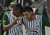 IBAGUÉ -COLOMBIA, 23-06-2013. Jefferson Duque (D) de Atlético Nacional celebra un gol en contra de Deportes Tolima durante partido de los cuadrangulares finales, fecha 3, de la Liga Postobón 2013-1 jugado en el estadio Manuel Murillo Toro de la ciudad de Ibagué./ Atletico Nacional player Jefferson Duque (R)celebrates a goal against Deportes Tolima during match of the final quadrangular 3th date of Postobon  League 2013-1 at Manuel Murillo Toro stadium in Ibague city. Photo: VizzorImage/STR