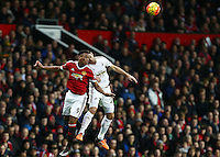 Anthony Martial of Manchester United and Angel Rangel of Swansea City during the Barclays Premier League match between Manchester United and Swansea City played at Old Trafford, Manchester on January 2nd 2016