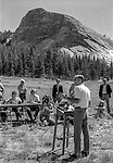 "Tuolumne Meadows, August 24, 1985:  Secretary of the Interior Don Hodel speaks to press with Lembert Dome in background.   Mount Ansel Adams, an 11,700 foot peak in a remote section of Yosemite National Park was dedicated Saturday, August 24, 1985, in a ceremony recognizing the famed photographer for his contribution to the American conservation movement. Adams was eulogized as a man who dedicated his life to photography and the preservation of planet Earth. The dedication ceremony was led by Adams' son, Dr. Michael Adams of Fresno, and attended by Adams' widow, Virginia Adams, Secretary of the Interior Donald Hodel, Sen. Alan Cranston, D-California, National Park Service Director William Penn Mott, actor Robert Redford, and other environmental and conservation leaders. In 1932, Ansel Adams and several Sierra Club companions first climbed the peak, according to Virginia Adams, who added that ""Ansel loved its tower shape. He called it 'The Tower' on the Lyell Fork of the Merced River. After they came down from climbing it, they sat around the campfire and one of them suggested that they name it Mount Ansel Adams."" Informally, that is what the Sierra Club did, calling the peak Mount Ansel Adams in the Sierra Club Guide until 53 years later the peak was finally officially named.  Photo by Al Golub/Golub Photography"