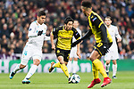 Borussia Dortmund Midfielder Shinji Kagawa (C) in action against Carlos Casemiro of Real Madrid (L) during the Europe Champions League 2017-18 match between Real Madrid and Borussia Dortmund at Santiago Bernabeu Stadium on 06 December 2017 in Madrid Spain. Photo by Diego Gonzalez / Power Sport Images