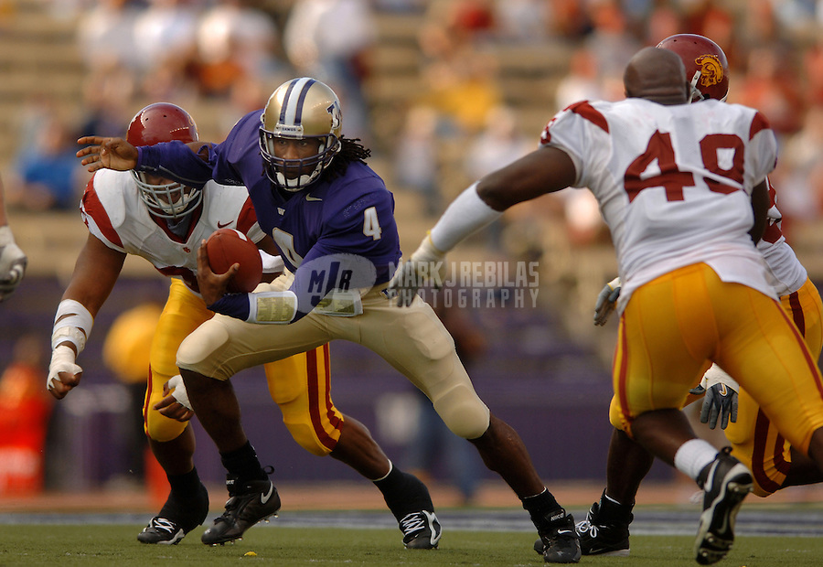 Oct 22, 2005; Seattle, WA, USA; Washington Huskies quarterback #4 Isaiah Stanback tries to evade the Southern California Trojans defense in the first quarter at Husky Stadium. Mandatory Credit: Photo By Mark J. Rebilas