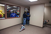 Children, many  of whom are American citizens overflow a crowded room at  an HOLA meeting in Painesville, Ohio. Hola meets weekly and people share deportation stories and inform other community members of thier ongoing immigration struggles. Thier children also come to the meetings at  LifeSpring HUB Christian Church. The youngest partcipate in activities in an adjacent storefront. March 25, 2014. Photo by Brendan Bannon.