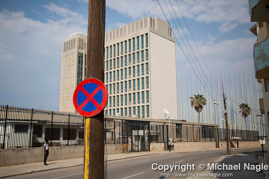 HAVANA, CUBA -- MARCH 25, 2015:   Guards stand outside the United States Embassy in Havana, Cuba on March 25, 2015. Photograph by Michael Nagle