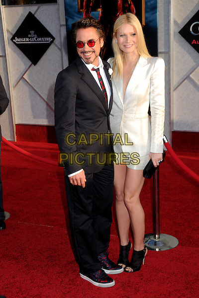 "ROBERT DOWNEY JR. & GWYNETH PALTROW .""Iron Man 2"" World Premiere held at the El Capitan Theatre, Hollywood, California , USA, .26th April 2010..arrivals full length shirt red striped tie suit tinted round clutch bag facial hair goatee beard  white silver shimmery shiny navy blue glasses sunglasses shorts trainers open toe shooboots ankle boots booties shoes .CAP/ADM/BP.©Byron Purvis/AdMedia/Capital Pictures."