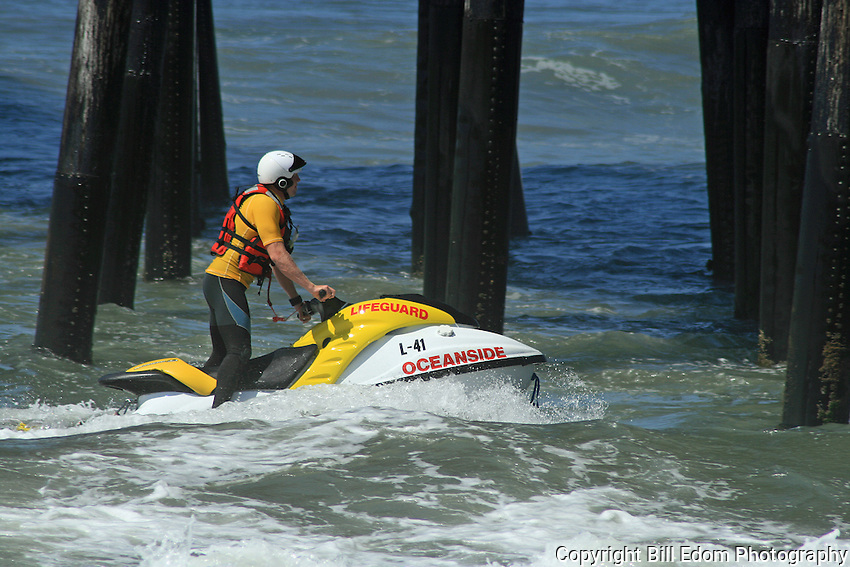 An Oceanside Lifeguard rides his jet ski under the Oceanside, California pier.