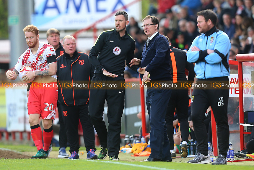 Glenn Roeder of Stevenage is spoken to by the fourth official during Stevenage vs Mansfield Town, Sky Bet EFL League 2 Football at the Lamex Stadium on 22nd April 2017