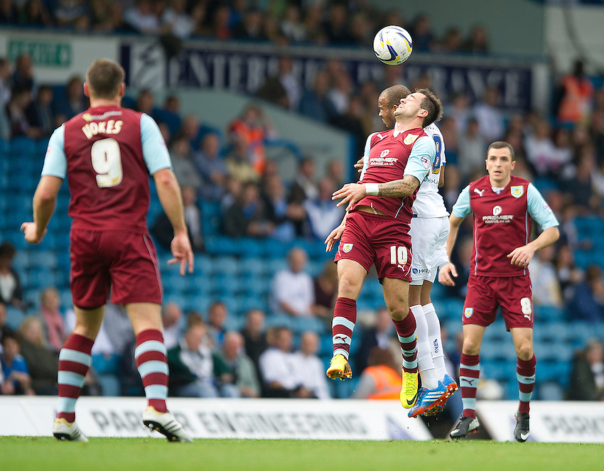 Burnley's Danny Ings battles with Leeds United's Rodolph Austin<br /> <br /> Photo by Stephen White/CameraSport<br /> <br /> Football - The Football League Sky Bet Championship - Leeds United v Burnley - Saturday 21st September 2013 - Elland Road - Leeds<br /> <br /> &copy; CameraSport - 43 Linden Ave. Countesthorpe. Leicester. England. LE8 5PG - Tel: +44 (0) 116 277 4147 - admin@camerasport.com - www.camerasport.com