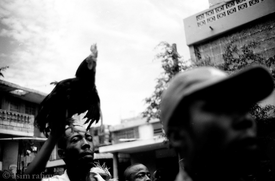 voodou ceremonies before the start of another pro-aristide demonstration in bel air - such peaceful protests are frequently met with violence and sniper firing at the hands of the haitian national police<br />