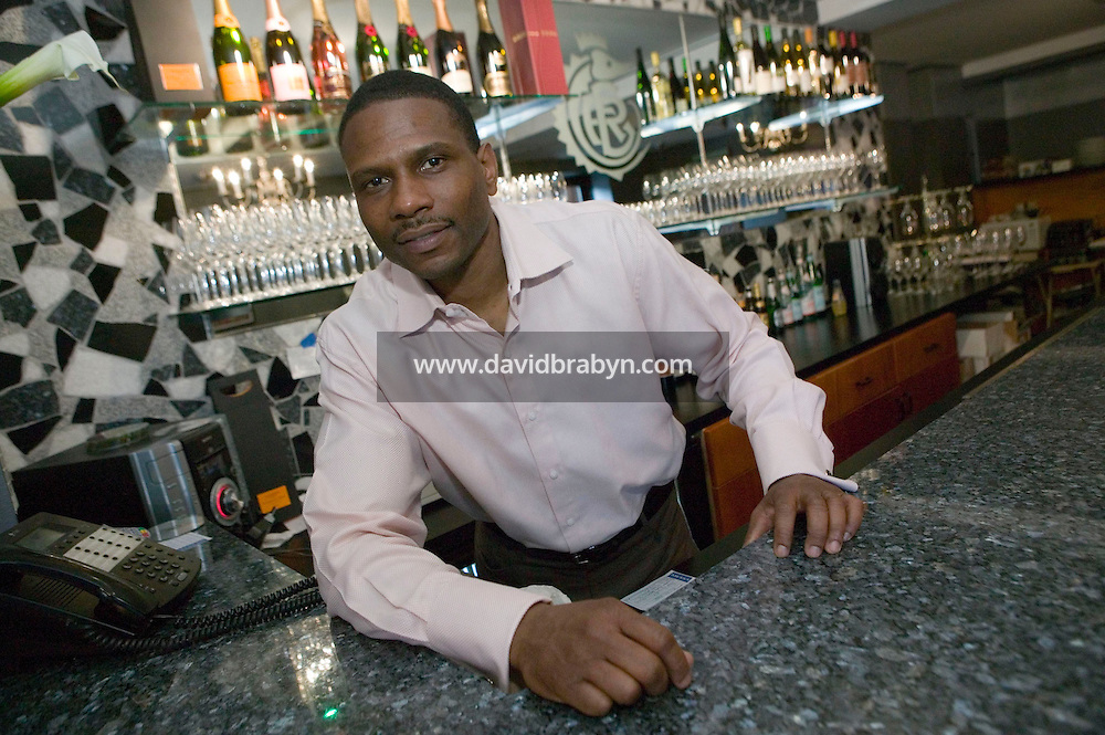 15 April 2006 - New York City, NY - David Mills, fouder and president of Emperor's Roe Caviar and Fina Foods, poses in the caviar boutique and tasting bar he recently opened in Harlem, the historically economically depressed neighborhood of Manhattan, in New York City, USA, 15 April 2006.