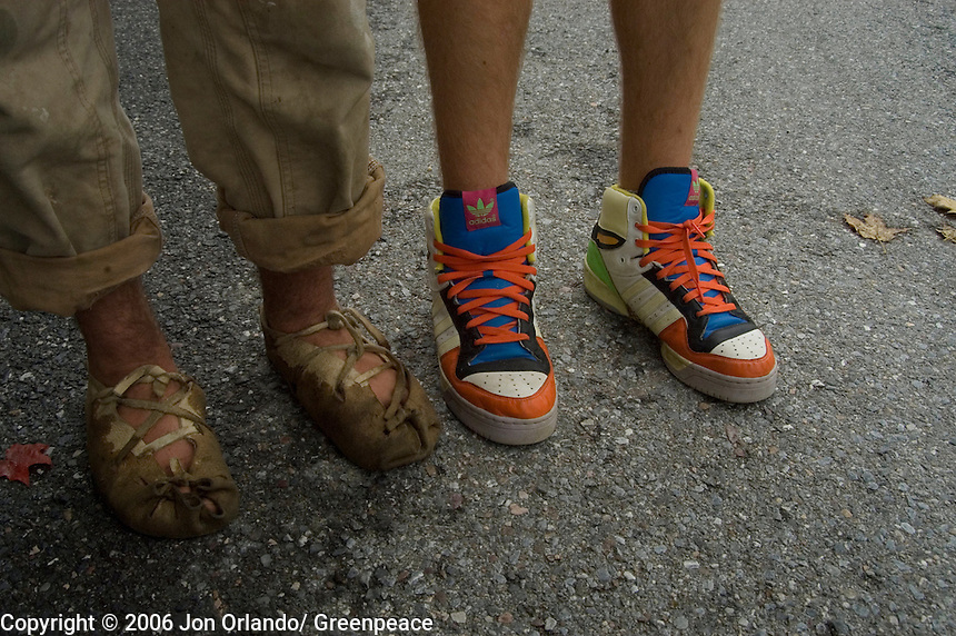 The walking shoes of Henry Romp (mocasins) and Dylan Hallsmith on the fourth day of a five day walk across Vermont to raise awareness on Global Warming.
