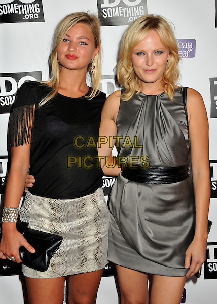 """JENNIFER AKERMAN & MALIN AKERMAN.DoSomething.org """"The Power of Youth"""" 2009 Teen Choice Awards Pre-Party held at Madame Tussauds, Hollywood, CA, USA..August 8th, 2009.Do Something half length grey gray silver dress black top skirt sisters siblings family tassels snake print clutch bag ackerman .CAP/ADM/BP.©Byron Purvis/AdMedia/Capital Pictures."""