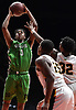 Luis Smikle, Jr. #10 of Farmingdale, left, scores on a putback during a Nassau AA-1 boys basketball game against Uniondale at NYCB Live's Nassau Coliseum on Monday, Dec. 17, 2018.