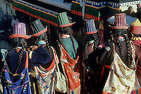 Ladakhi women wearing traditional SILK EMBROIDERED TALL HATS, TIKSE Monastery Masked Dances - LADAKH, INDIA