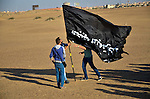 Members of the April 6 movement wave movement's flag as they protest against the detention of several members of their movement, near Cairo city, April 6, 2015. According to local media, the protest was held to mark the eighth anniversary of the movement by calling for the release of the detainees. Photo by Amr Sayed