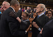 US President Barak Obama embraces US Supreme Court Justice Ruth Bader Ginsburg as US Supreme Court Justices Anthony M. Kennedy (L), Stephen G. Breyer (2nd R) and Sonia Sotomayor (R) look on before the President's State Of The Union address on January 20, 2015 at the US Capitol in Washington, DC. <br /> Credit: Mandel Ngan / Pool via CNP