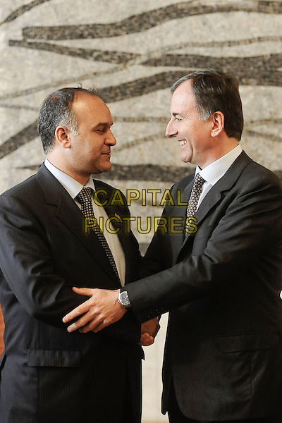 ALI ABD AL AZIZ ISAWI & FRANCO FRATTINI .Press conference of italian minister of Foreign Affairs, Franco Frattini (L), and the posted of the libic national transitory council, Ali Abd Al Aziz Al Isawi after their meeting about Libya issue, Rome, Italy..April 4th, 2011.half length black suit jacket side profile.CAP/EPS/GG.©Giuseppe Giglia/EPS/Capital Pictures
