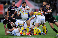 Ludovic Radoslavjevic of ASM Clermont Auvergne sends up a box kick as Richard Wigglesworth of Saracens attempts to block during the European Rugby Champions Cup  Round 1 match between Saracens and ASM Clermont Auvergne at the Twickenham Stoop on Saturday 18th October 2014 (Photo by Rob Munro)