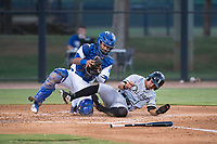 AZL White Sox shortstop Camilo Quintero (1) is tagged out by catcher Juan Zabala (54) during an Arizona League game against the AZL Dodgers at Camelback Ranch on July 7, 2018 in Glendale, Arizona. The AZL Dodgers defeated the AZL White Sox by a score of 10-5. (Zachary Lucy/Four Seam Images)