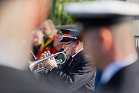 Pictured: A bugler plays the last post at the Cenotaph in Swansea, Wales, UK. Sunday 10 November 2019<br /> Re: Remembrance SUnday, a service to commemorate those who lost their lives in conflict has been held at the Cenotaph in Swansea, Wales, UK.