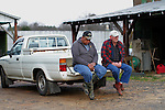 Tobacco farmer John Ashe, left, 44, sits with co-worker Robert Knight, right, before working on Ashe's Reidsville, NC, farm on Friday, Feb. 24, 2012.  North Carolina tobacco farmers fear they could lose much of their export business because the health industry wants to exclude tobacco products from a major trade agreement with eight Pacific Rim countries.   Photo by Ted Richardson