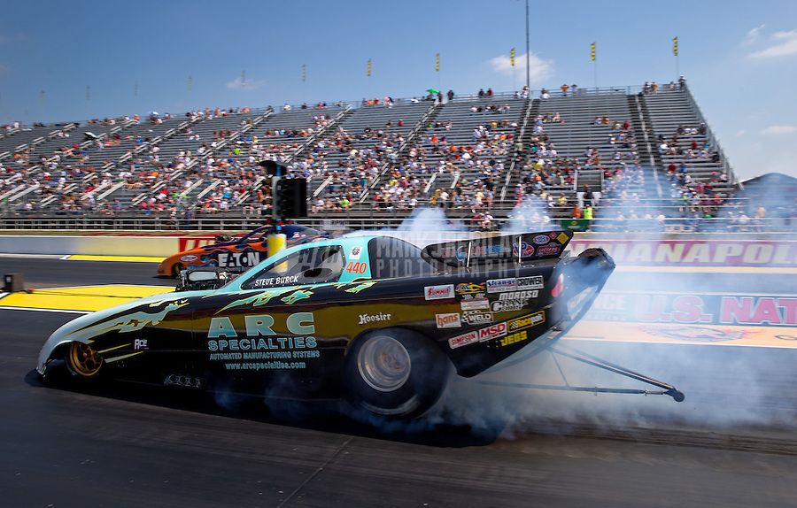 Aug. 30, 2013; Clermont, IN, USA: NHRA top alcohol funny car driver Steve Burck during qualifying for the US Nationals at Lucas Oil Raceway. Mandatory Credit: Mark J. Rebilas-